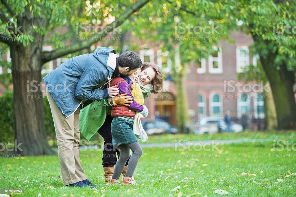 Father and Grandmother talking with their child royalty-free stock photo