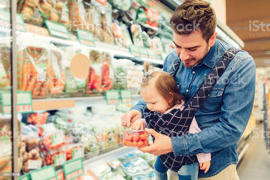 Father And His Baby Daughter Grocery Shopping. stock photo