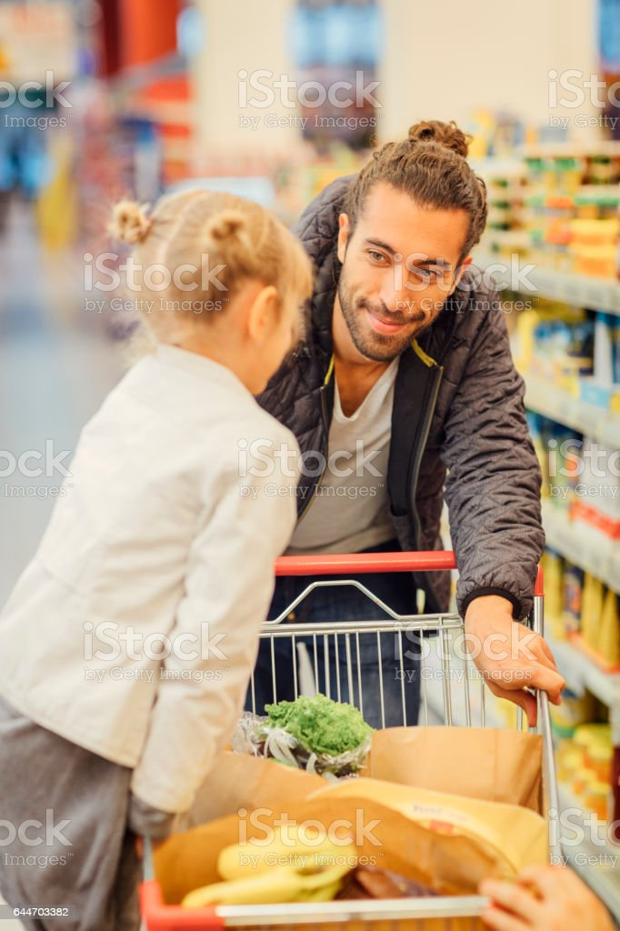 Father And His Daughter In A Supermarket stock photo