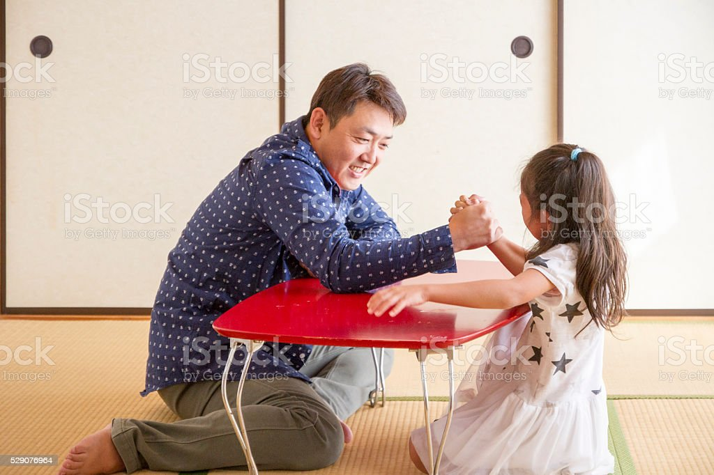 Father and his daughter playing at home stock photo