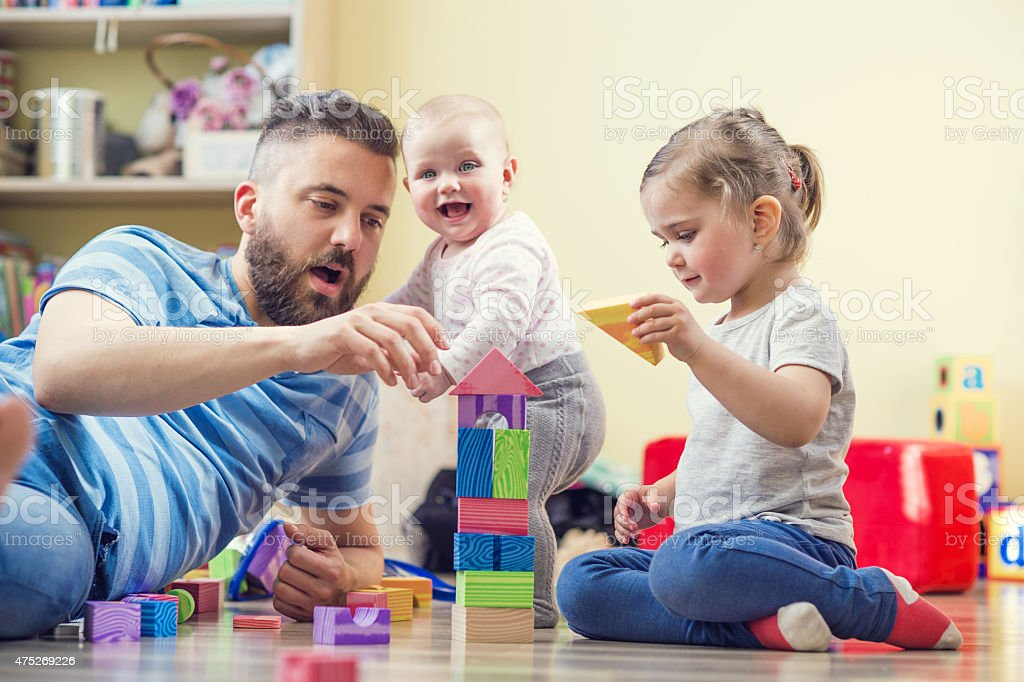 Father and his daughters stock photo