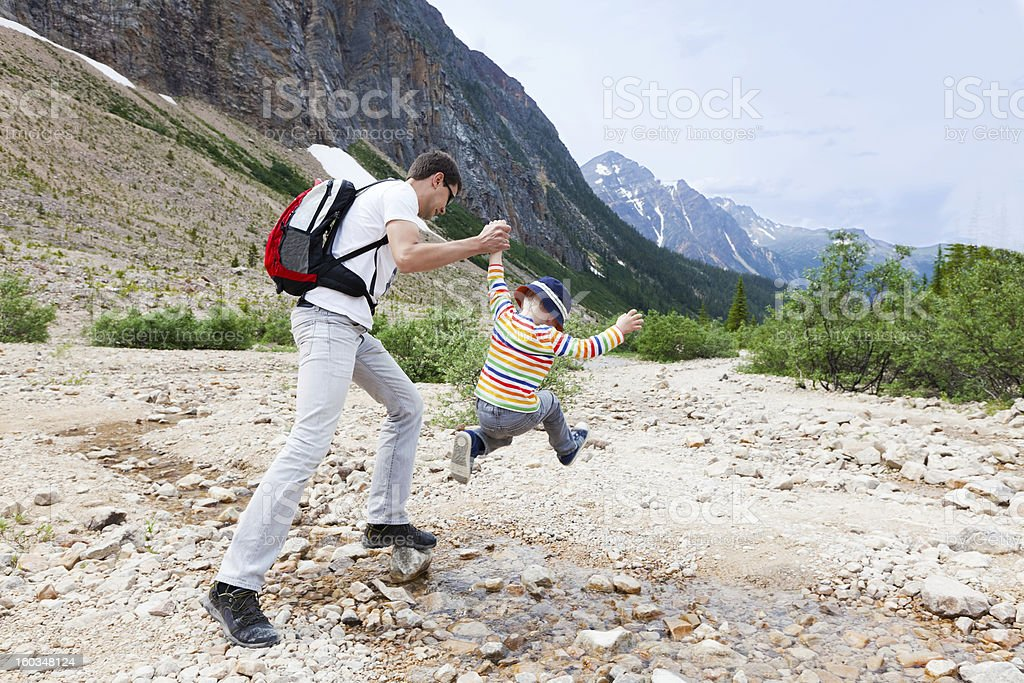 father and his son hiking royalty-free stock photo