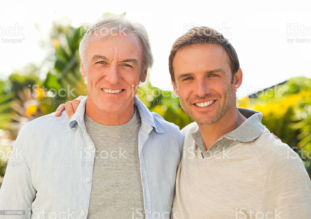 Father and his son looking at the camera stock photo