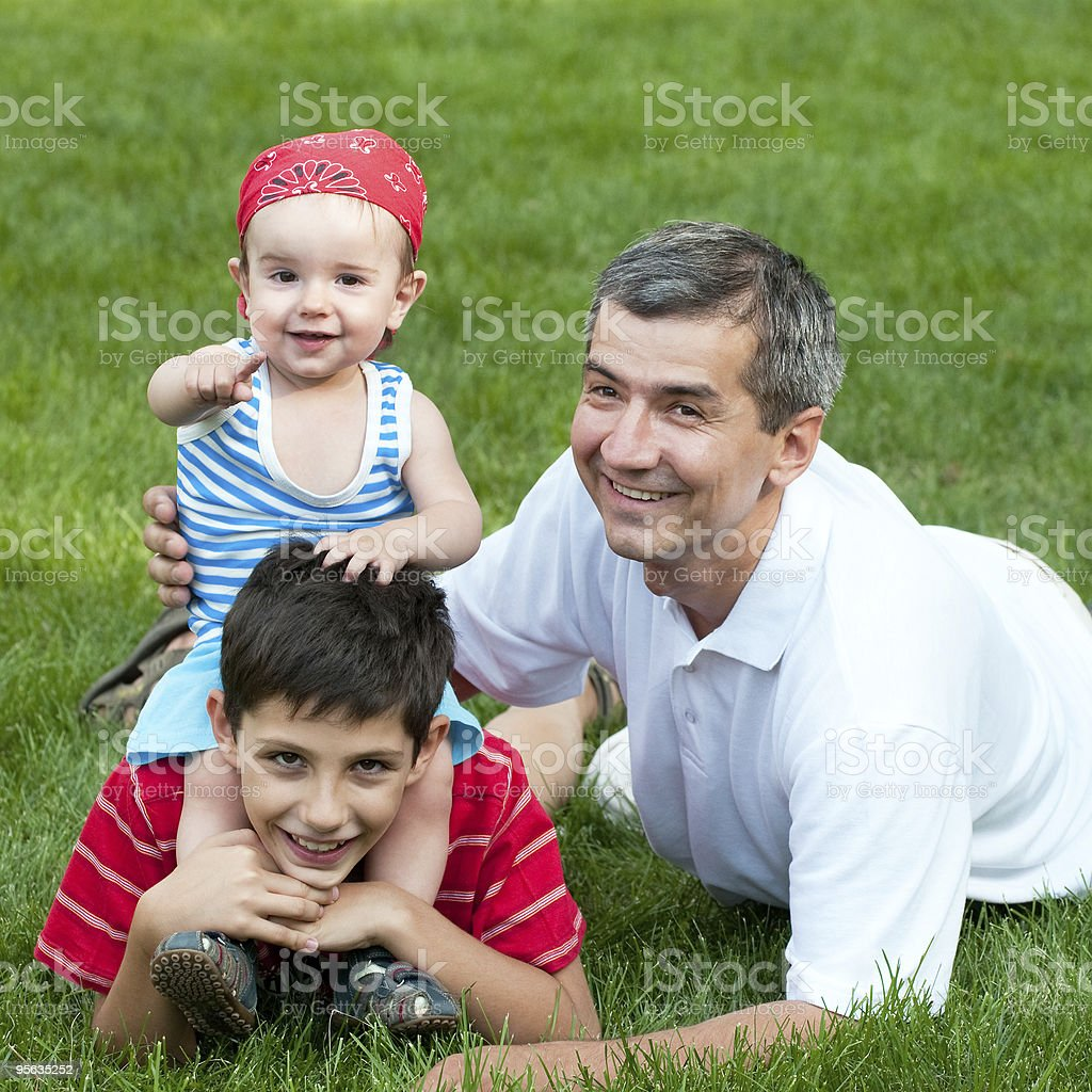 Father and his sons  in the park stock photo