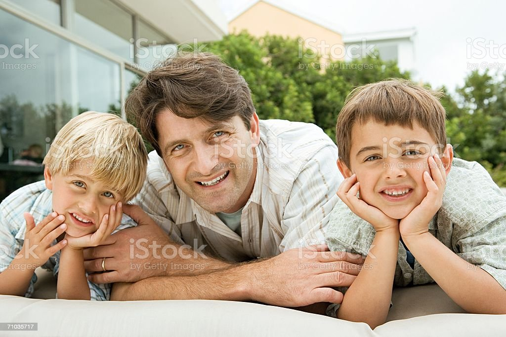 Father and his two sons royalty-free stock photo
