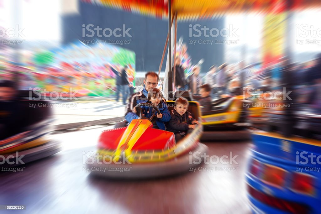 Father and his two sons,l having a ride stock photo