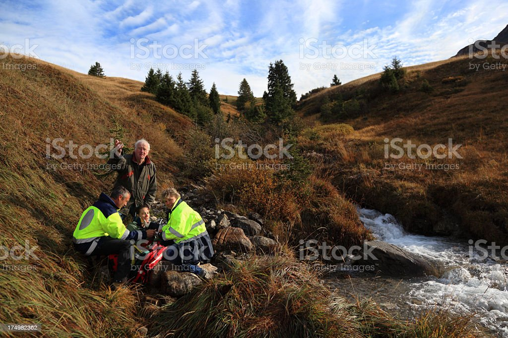 father and injured daughter rescued in Swiss Alps royalty-free stock photo