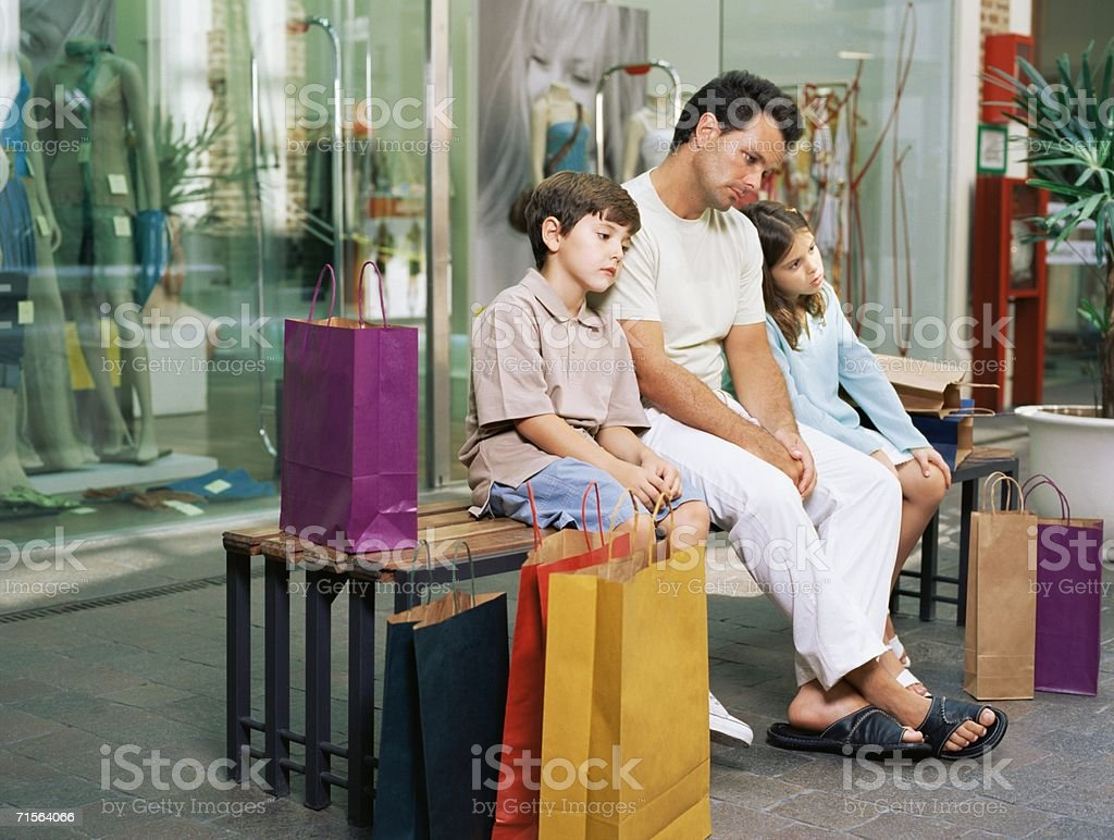 Father and kids bored with shopping royalty-free stock photo