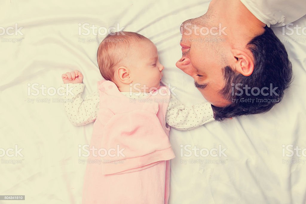 Father and little baby stock photo