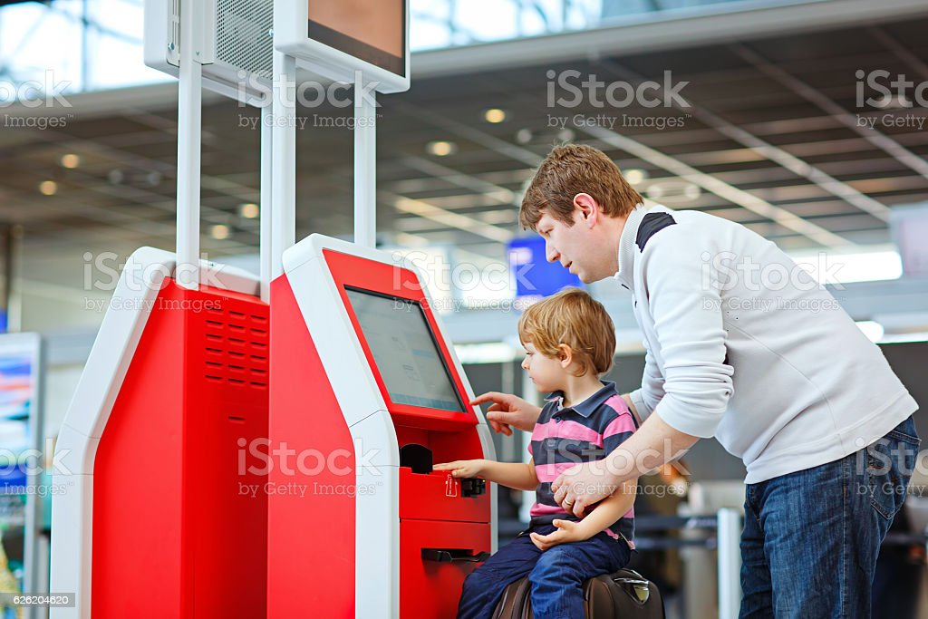 Father and little kid boy at the airport, traveling together stock photo