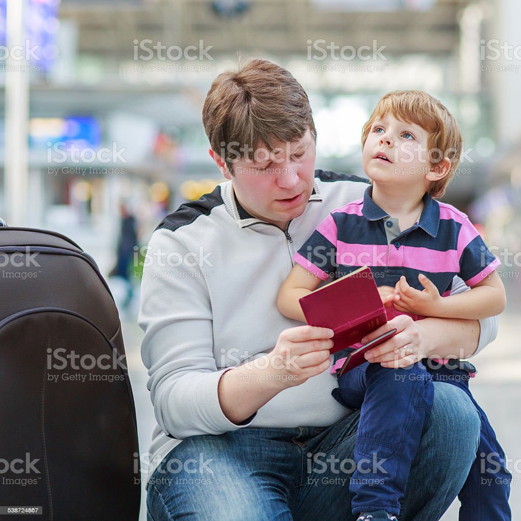 Father and little son at the airport stock photo