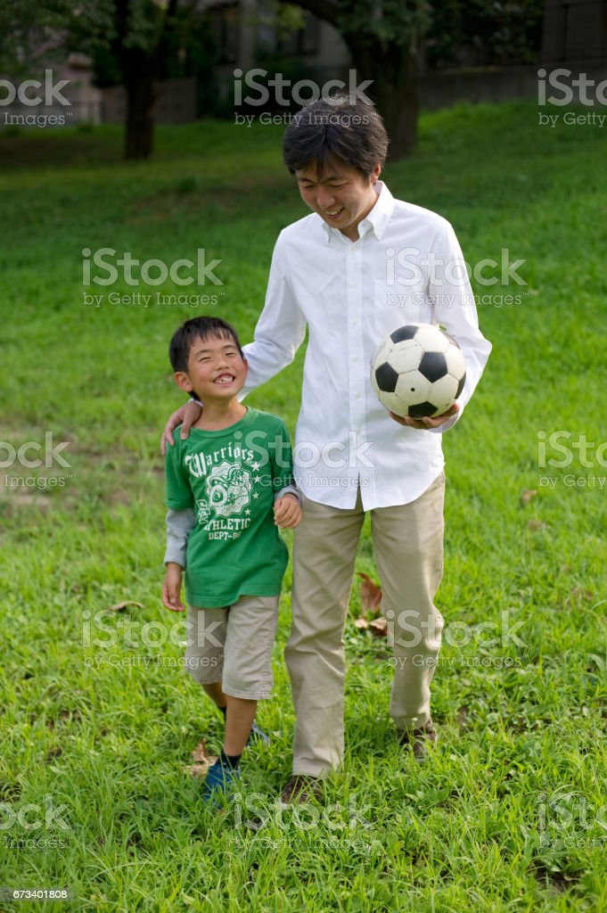 Father and son and soccer ball stock photo