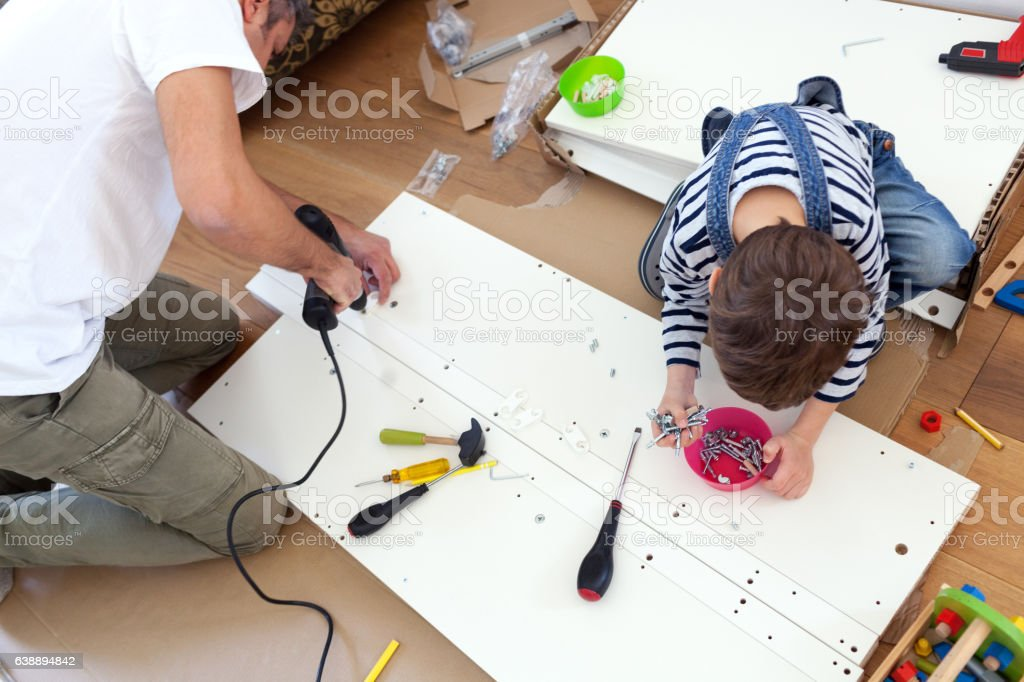 ... Father And Son Assembling Furniture Stock Photo ...