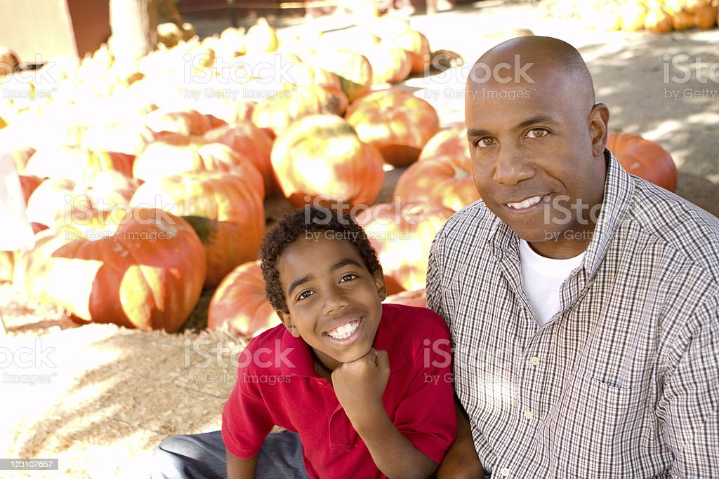 Father and son at a pumpkin patch royalty-free stock photo