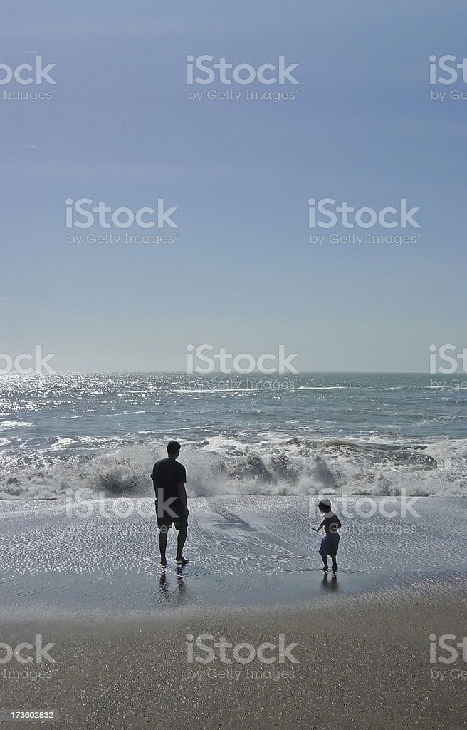 Father and Son at Beach - Our Environmental Legacy royalty-free stock photo