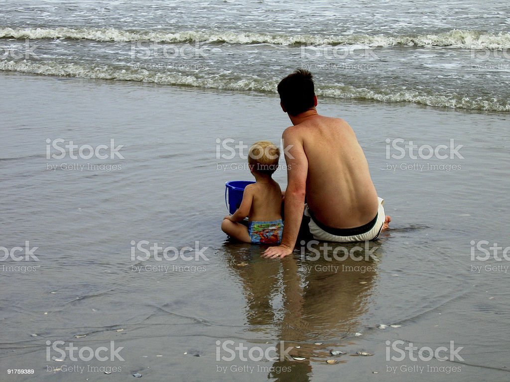 Father And Son At Beach royalty-free stock photo