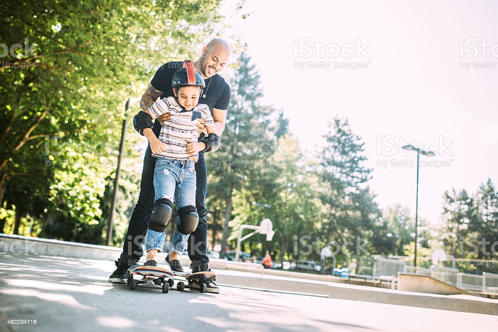 Father and Son at Skate Park stock photo