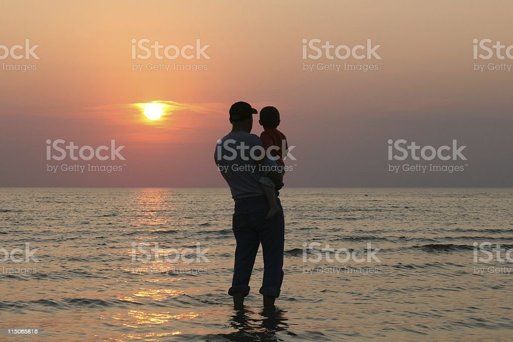 Father and Son at Sunset royalty-free stock photo