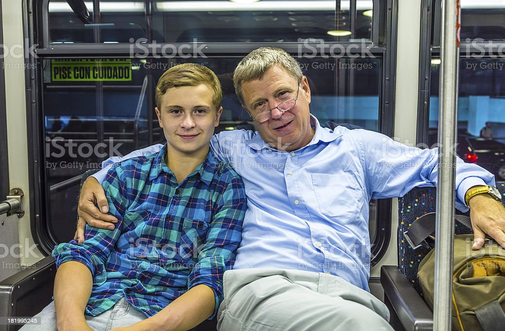 father and son at the airport bus after arrival stock photo