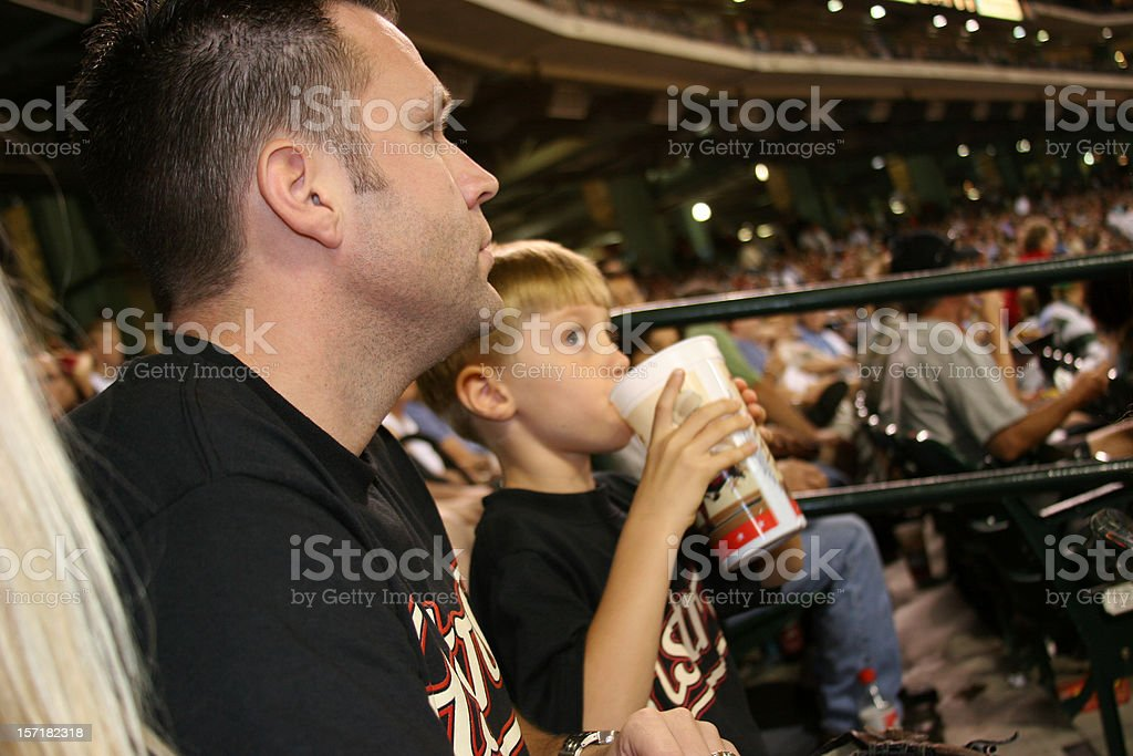 Father and son at the baseball game. Sports stadium. Ballpark. stock photo