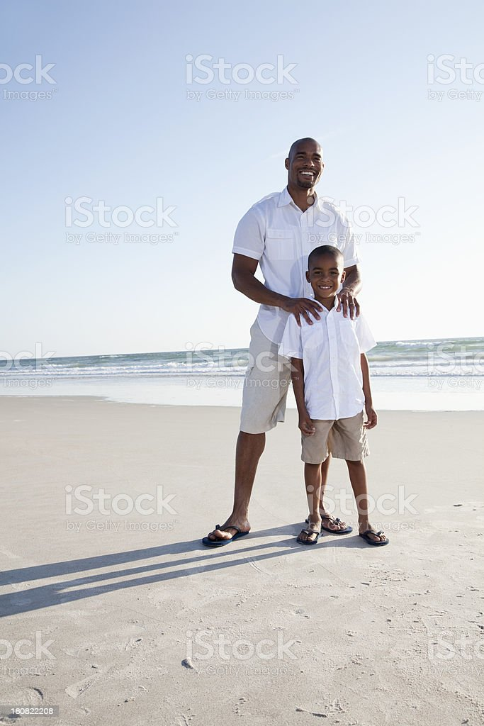 Father and son at the beach stock photo