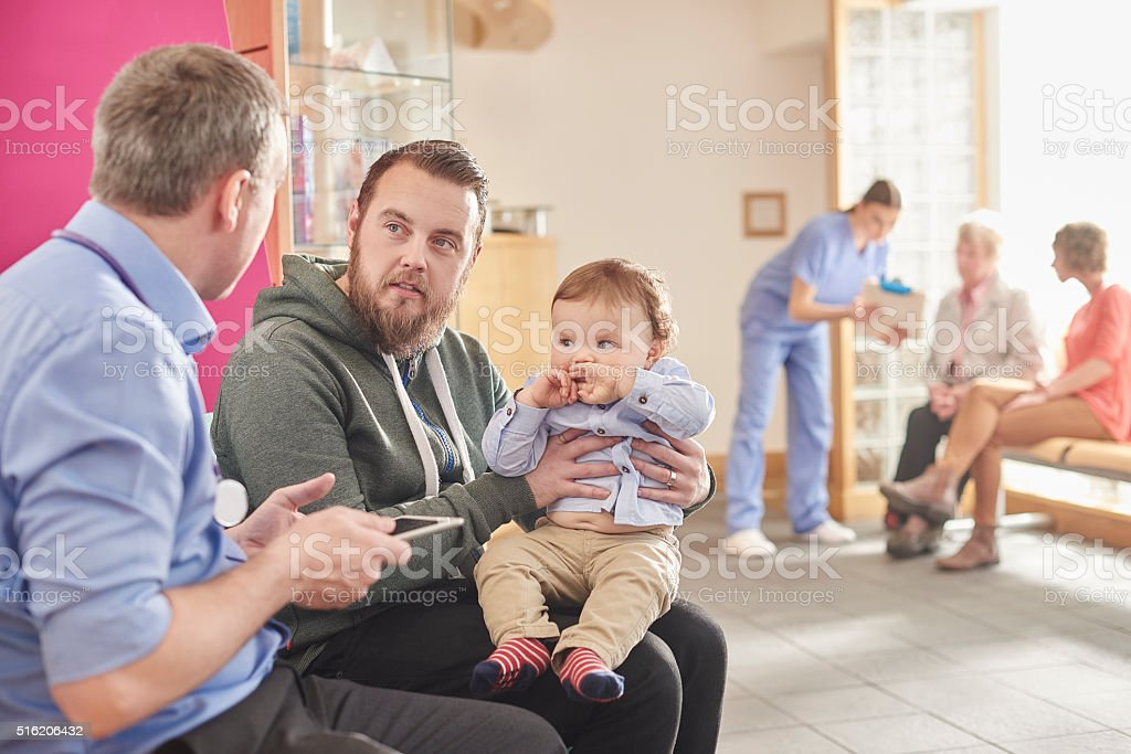 father and son at the clinic stock photo