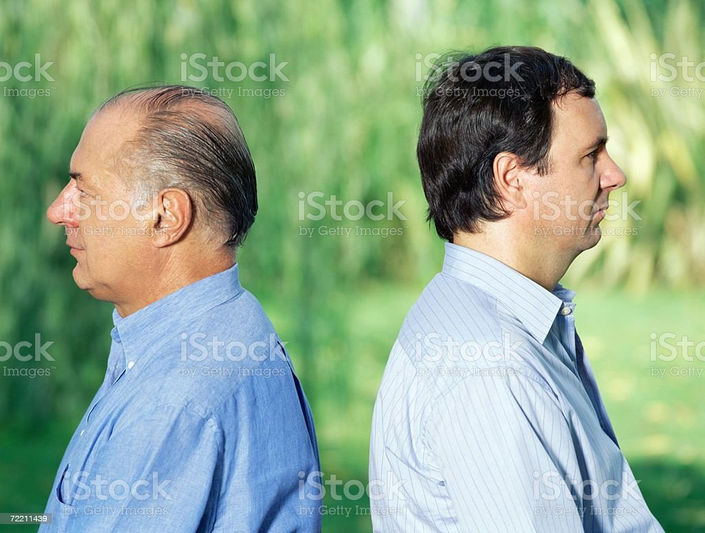 Father and son back to back royalty-free stock photo