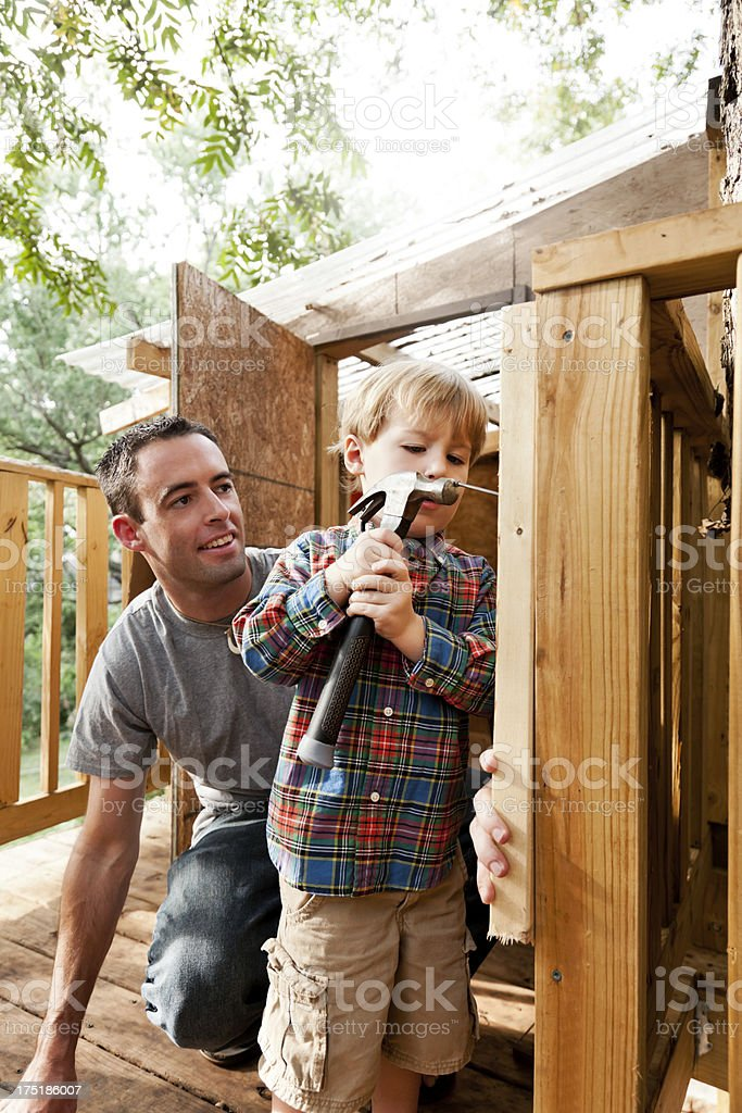 Father and Son Build Tree House royalty-free stock photo