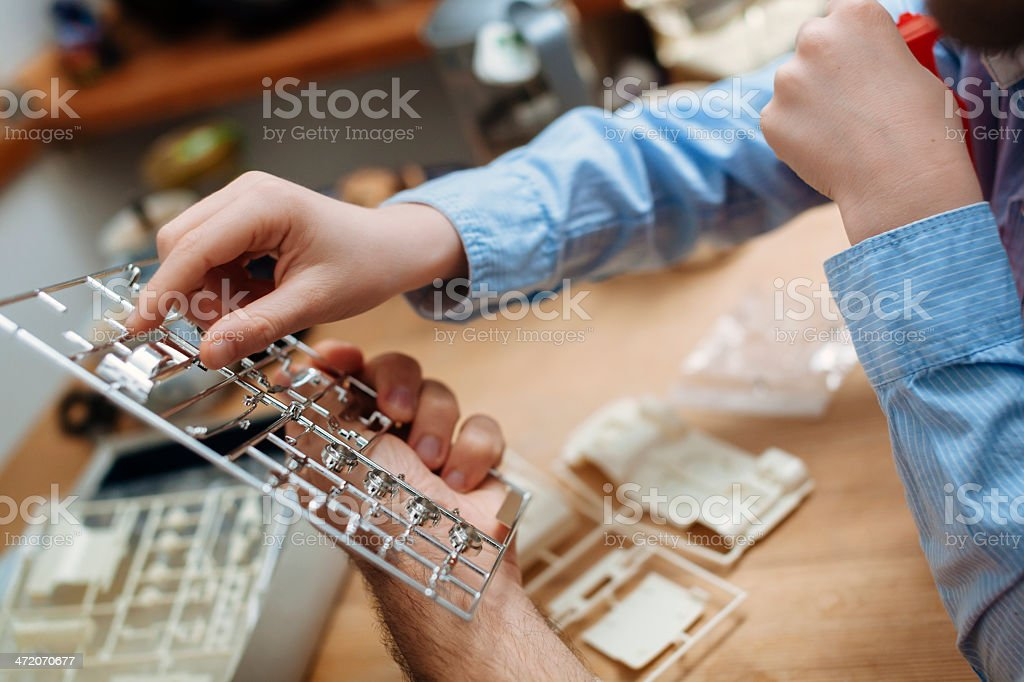 Father and son building model car stock photo