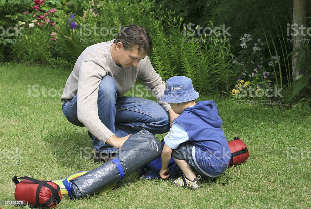 Father and son camping royalty-free stock photo