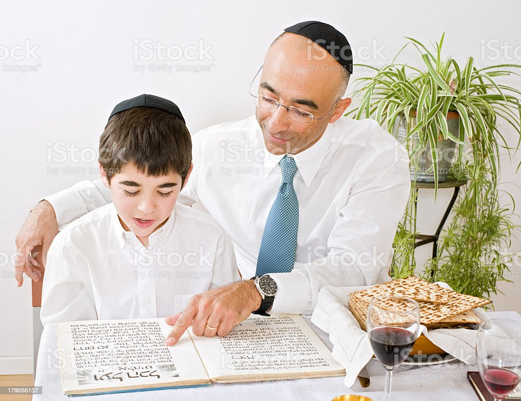 father and son celebrating passover stock photo
