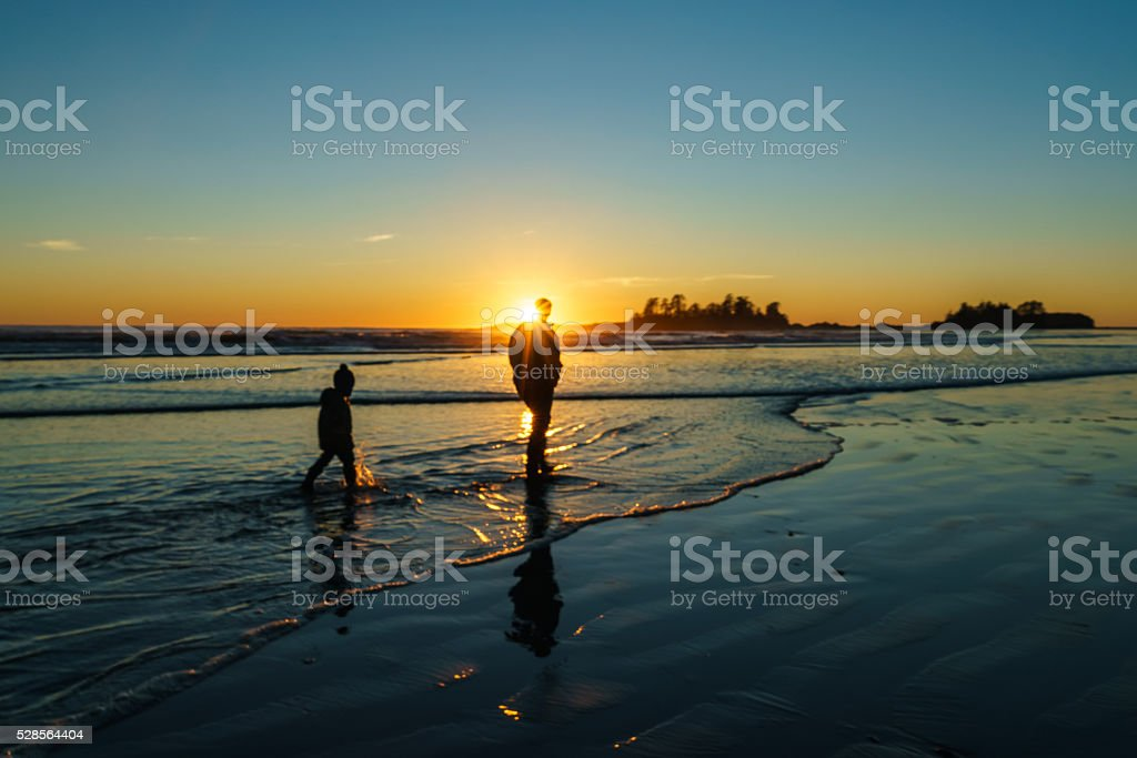 Father and son Chesterman Beach in Tofino stock photo