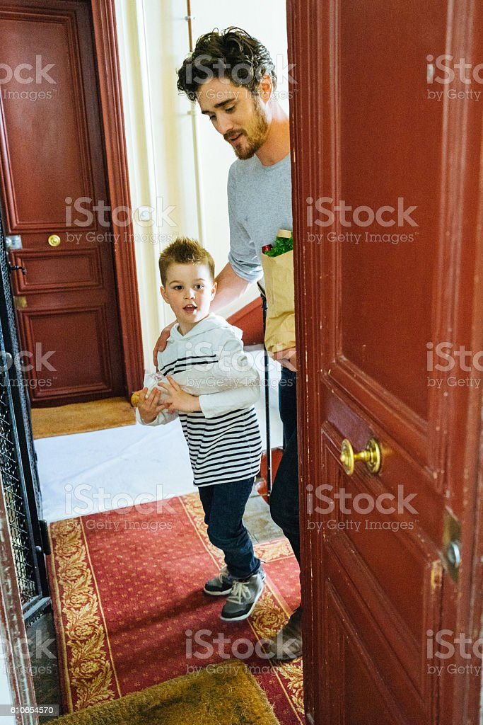 Father And Son Coming Back Home With Fresh Food stock photo