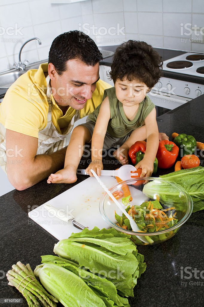 father and son cooking in kitchen royalty-free stock photo