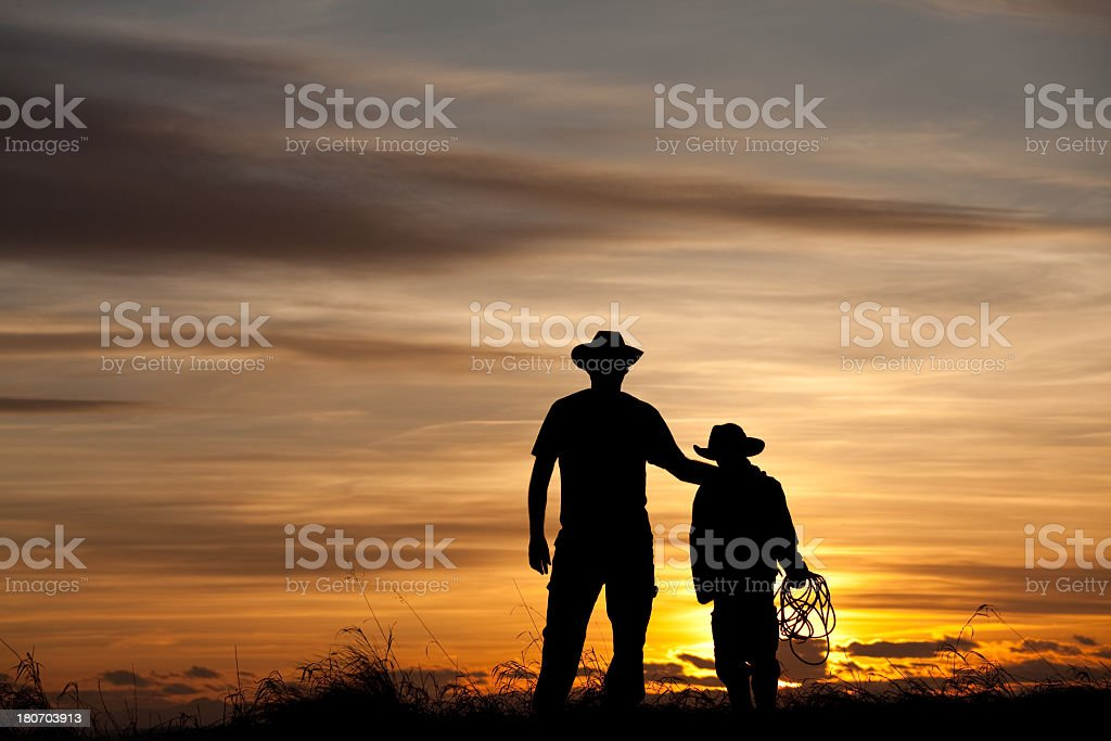 Father and Son Cowboy Silhouette royalty-free stock photo