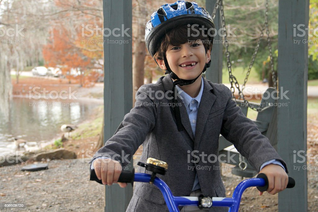 Father and son cycling with help scaffolding stock photo