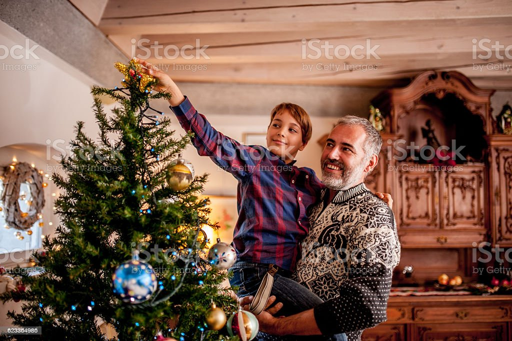Father and Son Decorating the Christmas Tree stock photo