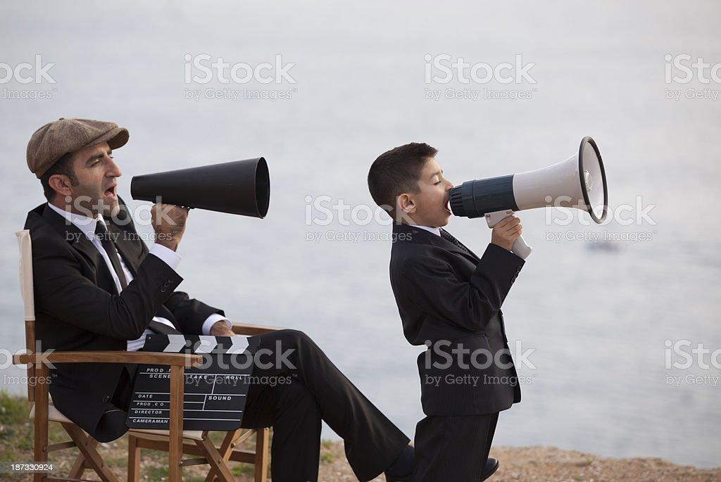Father and son directing cinema film stock photo