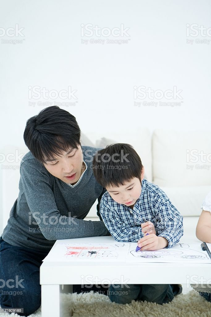 Father and son drawing royalty-free stock photo