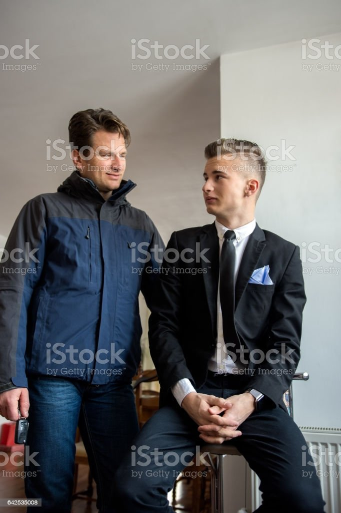 Father and son early in the day at home stock photo