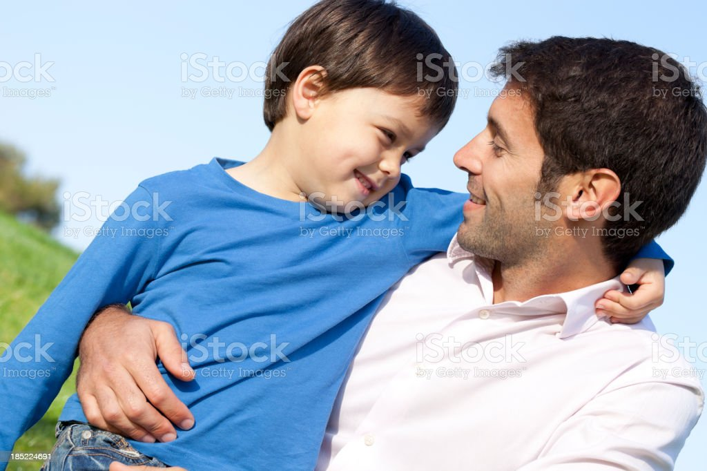 father and son embracing royalty-free stock photo