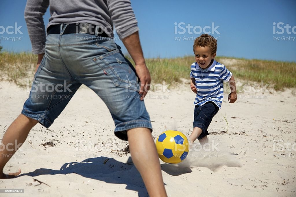 Father and Son Enjoying Football Game royalty-free stock photo