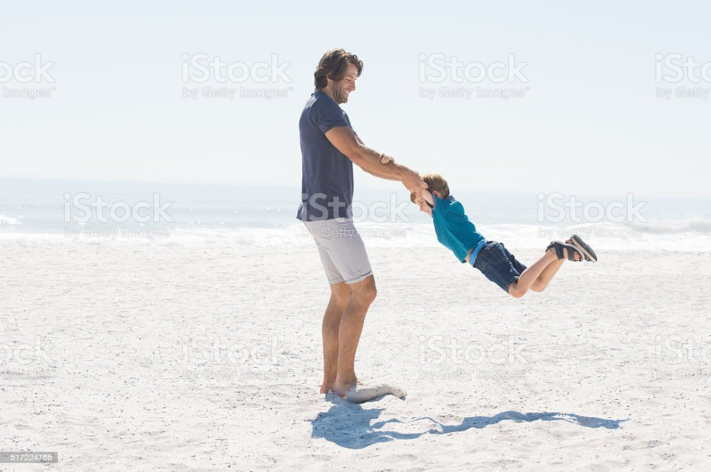 Father and son enjoying stock photo