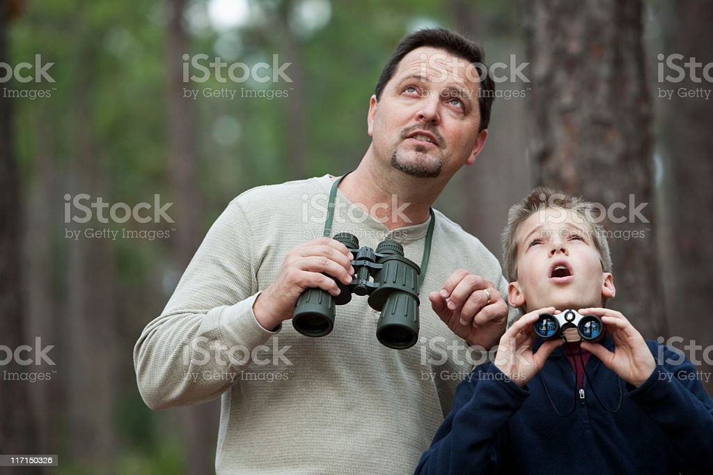 Father and son enjoying scenic view with binoculars royalty-free stock photo