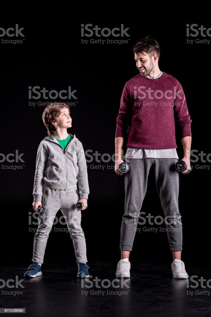 Father and son exercising stock photo