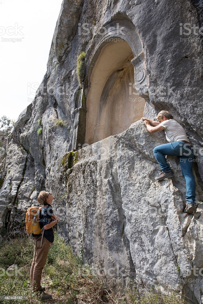 Father and son explore site of ancient Greek ruin stock photo
