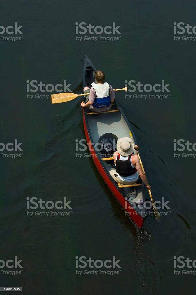 Father and son exploring by canoe royalty-free stock photo