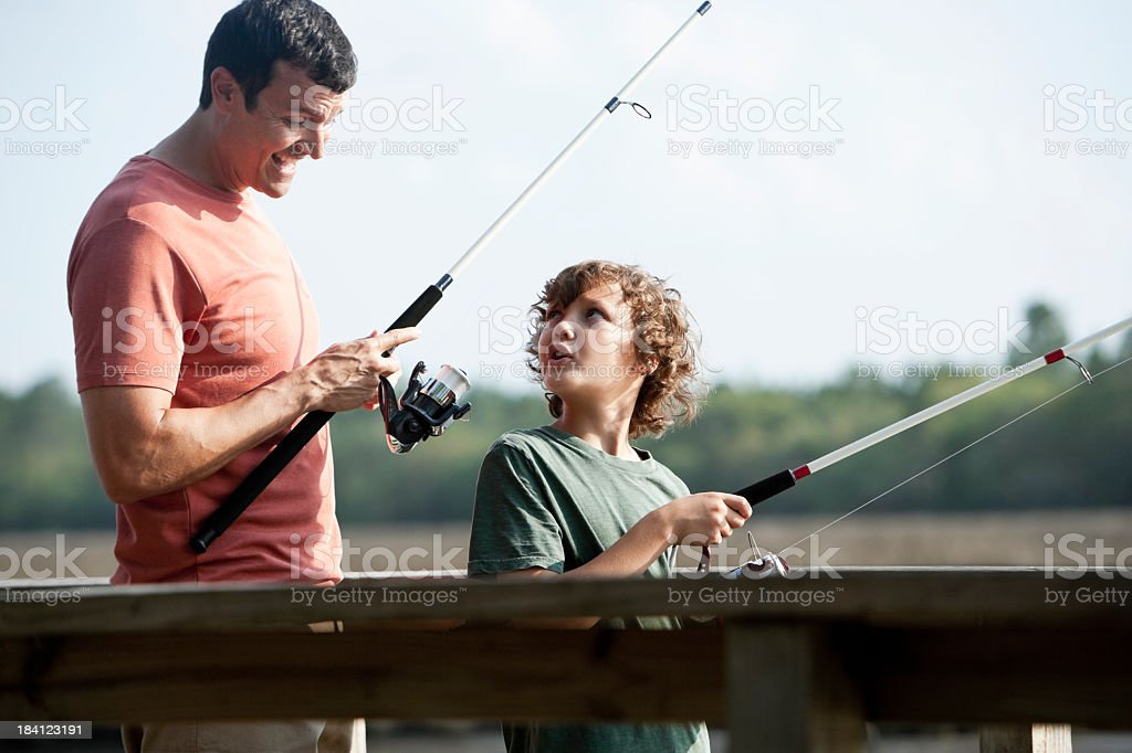 Father and son fishing stock photo