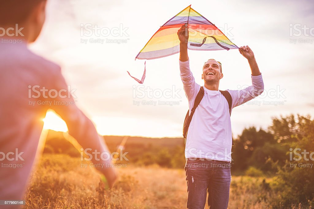 Father and son flying kites stock photo