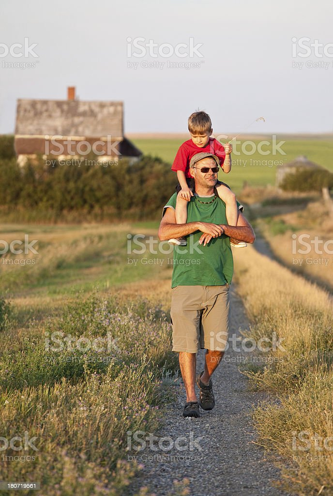 Father and Son Going For a Walk royalty-free stock photo